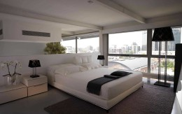 Modern leather Nick bed with adjustable headrests by Cierre